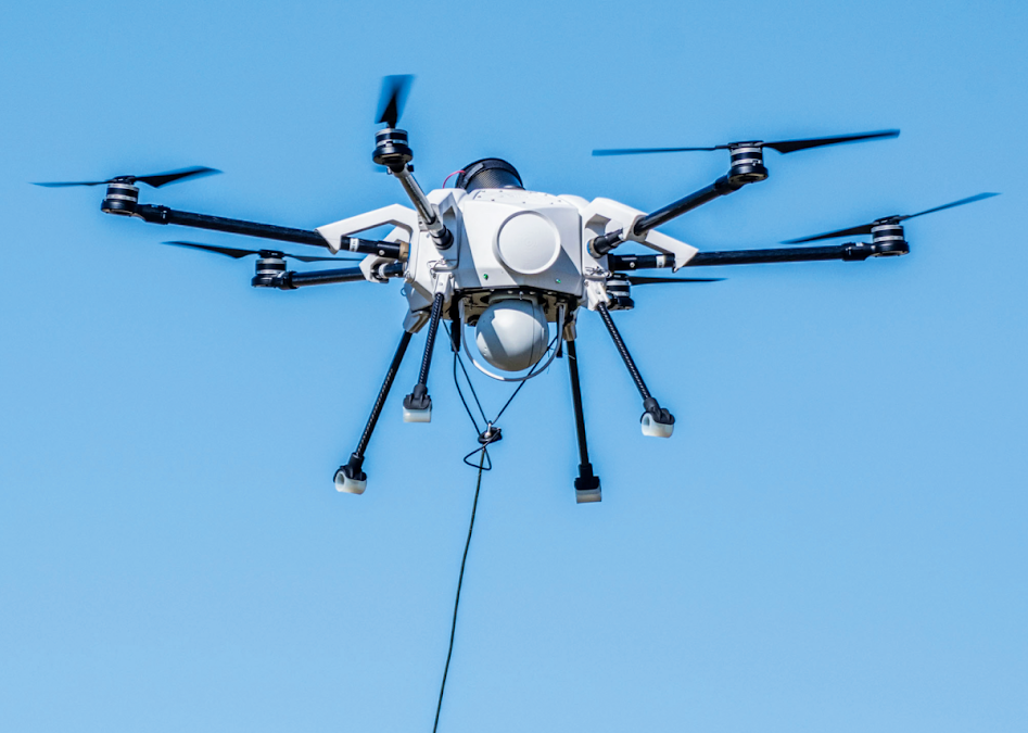 Tethered drone system for surveillance and telecommunications