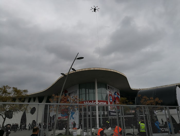 Tethered drone over public gathering